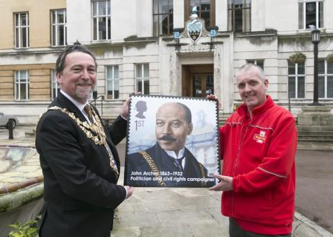 Wandsworth Mayor Adrian Knowles being presented with enlarged stamp of John Archer by local Wandsworth postman John O'Hanlon