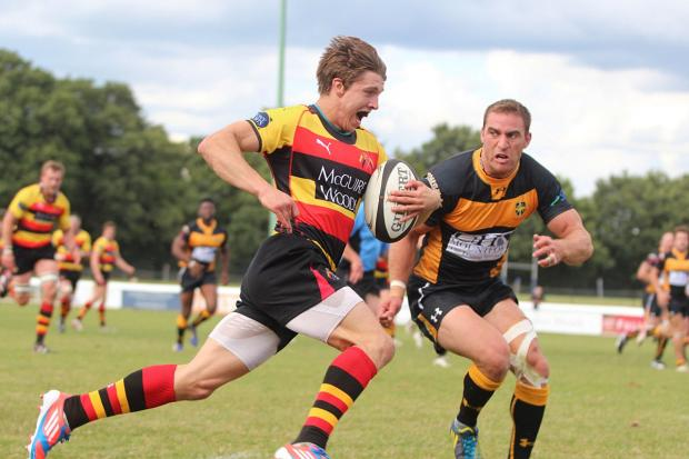 Happy times: Esher celebrate a Jay Udo-Udoma try in the 28-22 win at neighbours Richmond          SP79128