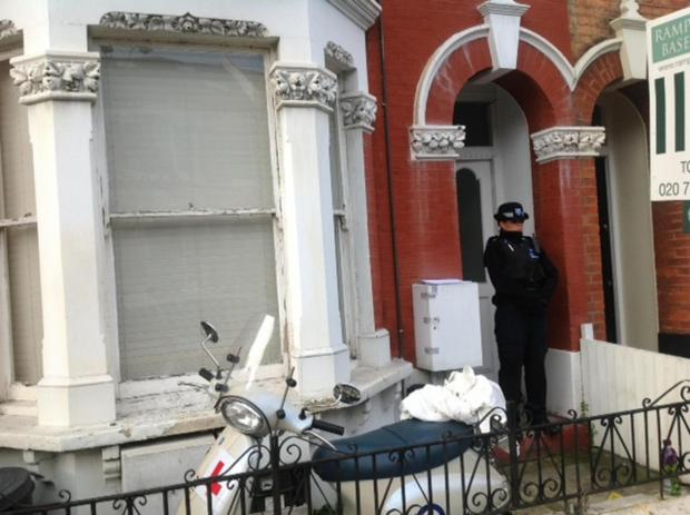 Wandsworth Guardian: Police outside the flat in Lavender Sweep, Battersea