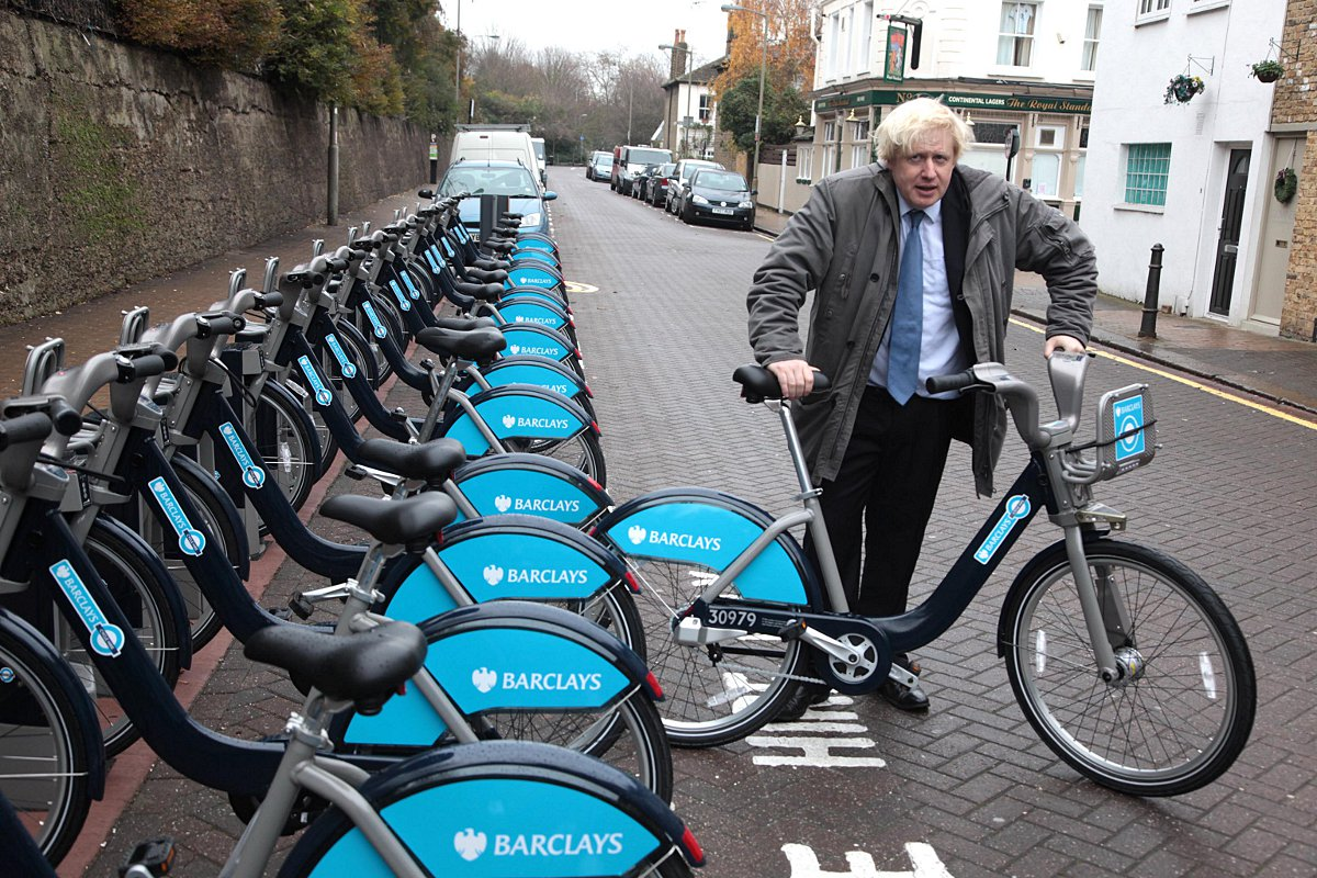 Boris Johnson docks a bike at Wandsworth Town Station