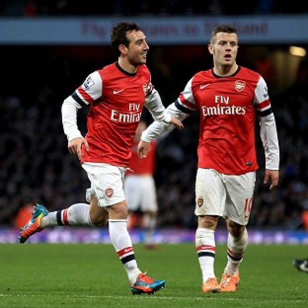 Wandsworth Guardian: Santi Cazorla, left, scored a second-half brace to claim all three points for Arsenal