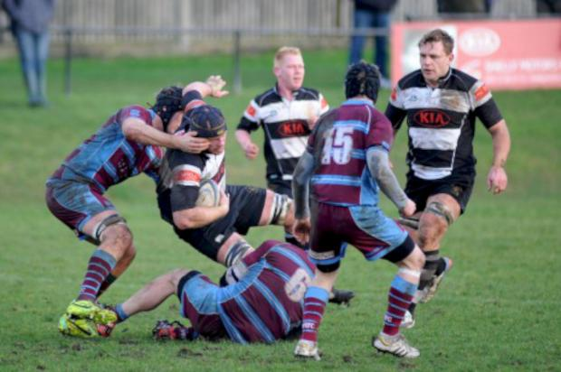 Wandsworth Guardian: Battle: Sutton & Epsom's Mike Blakeburn is tackled during the 22-10 defeat to neighbours Wimbledon                             Pictures: Ben Mole/Sutton & Epsom RFC