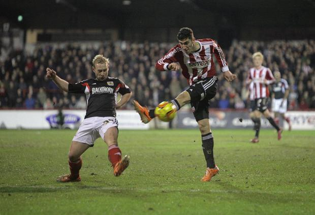 Wandsworth Guardian: On target again: Brentford striker Marcello Trotta saw his penalty saved but forced home the rebound to open the scoring at Shrewsbury Town