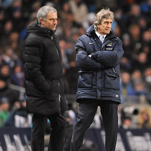 Jose Mourinho, left, and Manuel Pellegrini face one another in opposing dugouts on Saturday