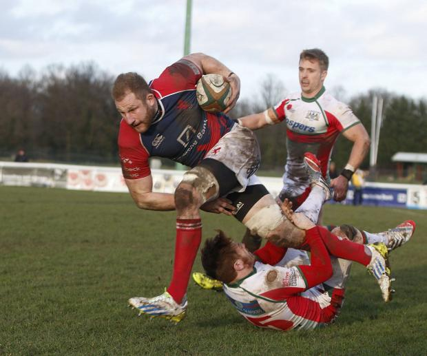 Wandsworth Guardian: Unstoppable: Scottish captain Mark Bright tests the Plymouth