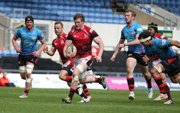 Wandsworth Guardian: Running with the ball: London Welsh flanker John Quill bursts through the jersey defence at the Kassam stadium on Saturday