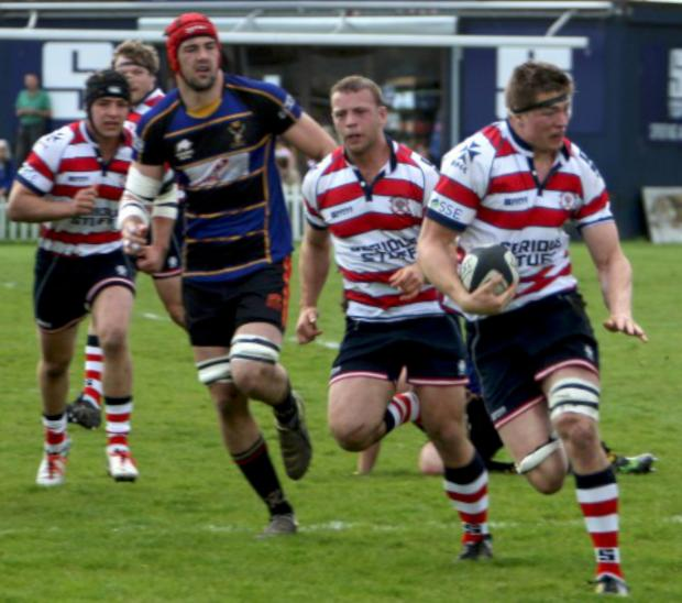 Get out my way: Tom Baldwin on the charge in Rosslyn Park's eight-try win over Cinderford on Saturday                A