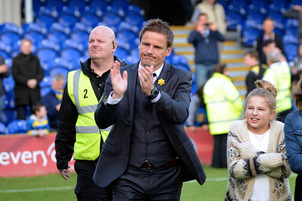 Glum: Neal Ardley salutes the crowd at the final whistle last weekend            SP81984