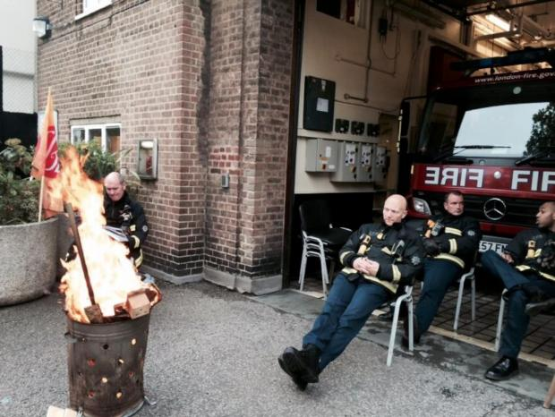 Wandsworth Guardian: Firefighters outside Battersea Fire Station during the strike on Friday, May 2