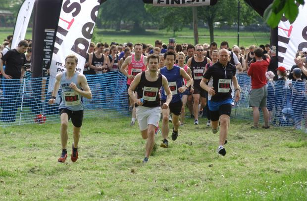 Runners take part in the Miles for Missing People 10k in Clapham Common