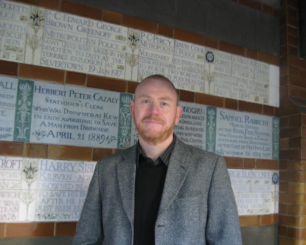 Dr Price in front of the Watts Memorial to Heroic Self Sacrifice