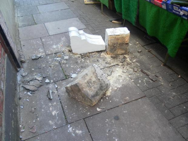Falling masonry narrowly misses shoppers
