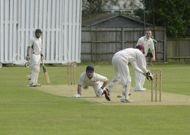Out of his ground: Malden Wanderers opener Alex Redmayne is run out for nine in Saturday's seven wicket Surrey Championship Division one win over Cheam