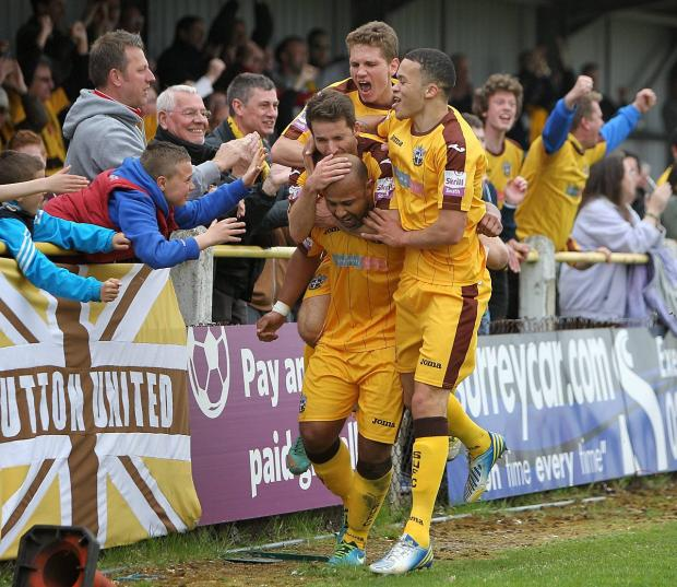 Happy memories: Simon Downer is mobbed after scoring the 3-1 win over Ebbsfleet at the back end of last season               All pictures: Paul Loughlin