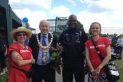 Mayor Stuart Thom buying a geranium from charity group FACE