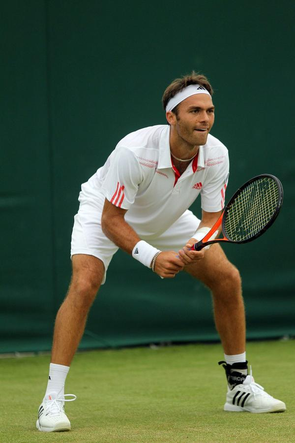 Determined: Ross Hutchins' return to action at Wimbledon was short-lived, but h