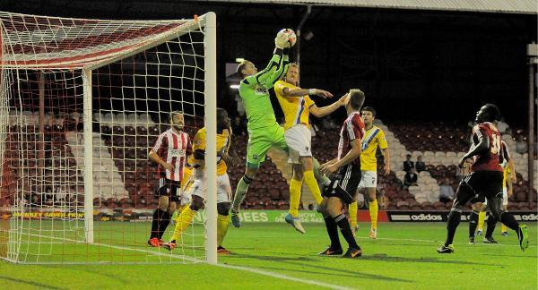Debut: Action from Luke Norris' first team debut for Brentford against AFC Wimbledon