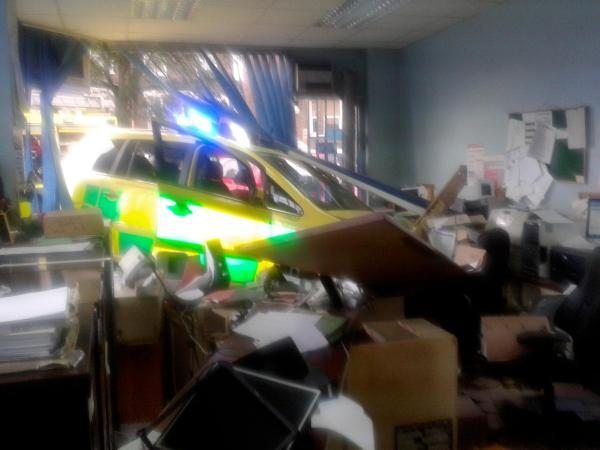 The ambulance plowed through the front of the business