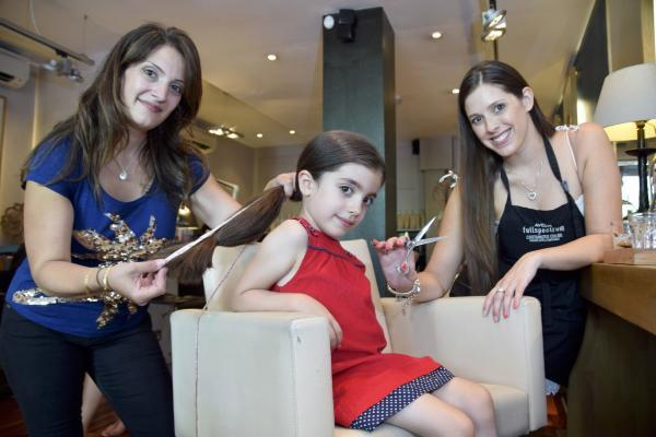 Carla and Alessandra Shohet with hairdresser Natalie Joy Love before the haircut