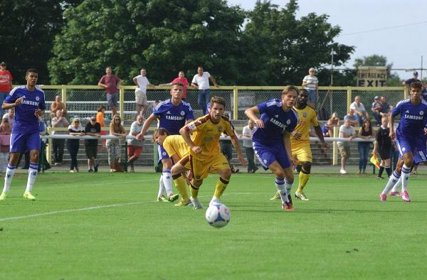 The chase is on: Jamie Taylor in action against Chelsea U21s in the pre-season home curtain raiser on Saturday