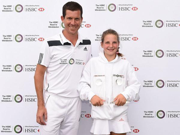On the up: Surbiton's Alice Klugman with English tennis legend Tim Henman and her trophies