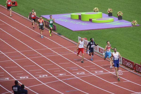 Tiring: Martyn Rooney brings home the 4x400m relay team at