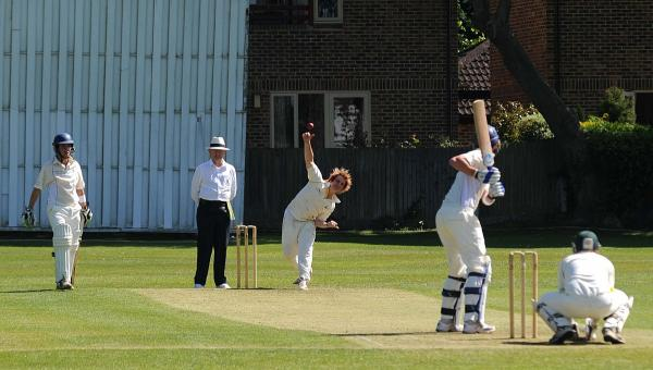 On the ball: Tom Deighton in action with the ball for promotion-bound Ashtead