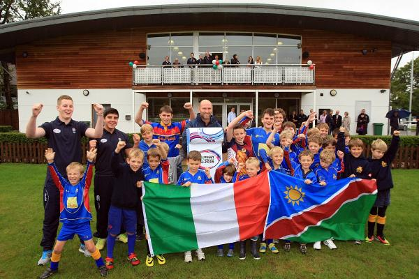 Great day: Cobham youngsters celebrate the news their club will be an official World Cup team base                  All pictures: DeadlinePix SP87143