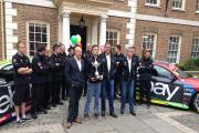 Time to refelct: British Touring Car Championship winner Colin Turkington, centre, poses with the trophy and the rest of the West Surrey Racing team at title sponsor eBay Motors' Richmond HQ in Heron Square last Friday 	 	Picture: Stuart Amos