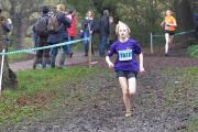 Muddy hell: Alex Brown brings Wandsworth home in the opening event of this year's London Youth Games