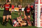In there somewhere: Jack Gash goes over for one of his two tries at Hartpury College last weekend             Picture: David Whittam