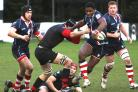 Defeat: Rosslyn Park's Joe Ajuwa struggles to break free of the Blackheath defence           All pictures: David Whittam