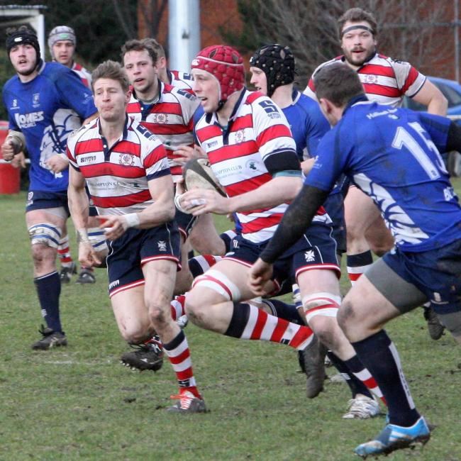 Watch out: Rosslyn Park lock Richard Boyle bursts through against the Macclesfield back line          All pictured: David Whittam