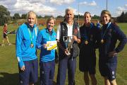 Proud: Old Emanuel director of rugby Fergus McCarthy, centre, with England Women's World Cup winners
