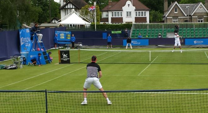 Saville (wearing black and white) in action at last year's Surbiton Challenger