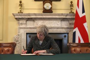 Theresa May signs the letter that will lead to Britain leaving the EU