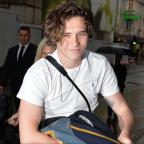 Wandsworth Guardian: Brooklyn Beckham supported by parents Victoria and David at book event
