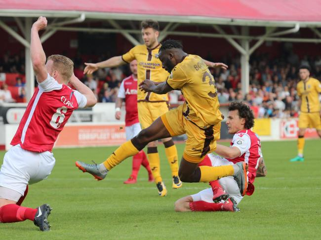 Tom Bolarinwa lashes the ball past Nathan Ashmore as Sutton United won 1-0 at Ebbsfleet United on Saturday. Picture: Paul Loughlin