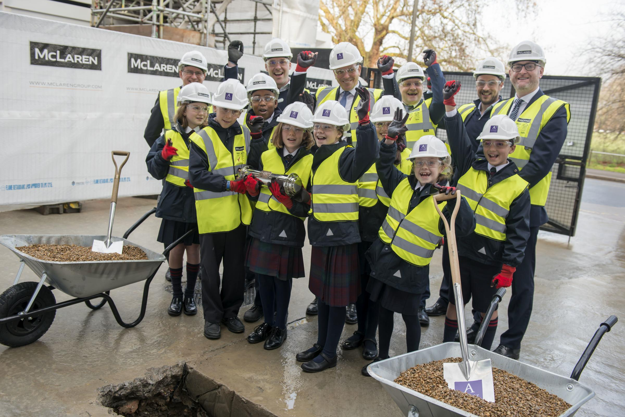 Students from Oliver House School in Clapham bury a time capsule at the new retirement village.