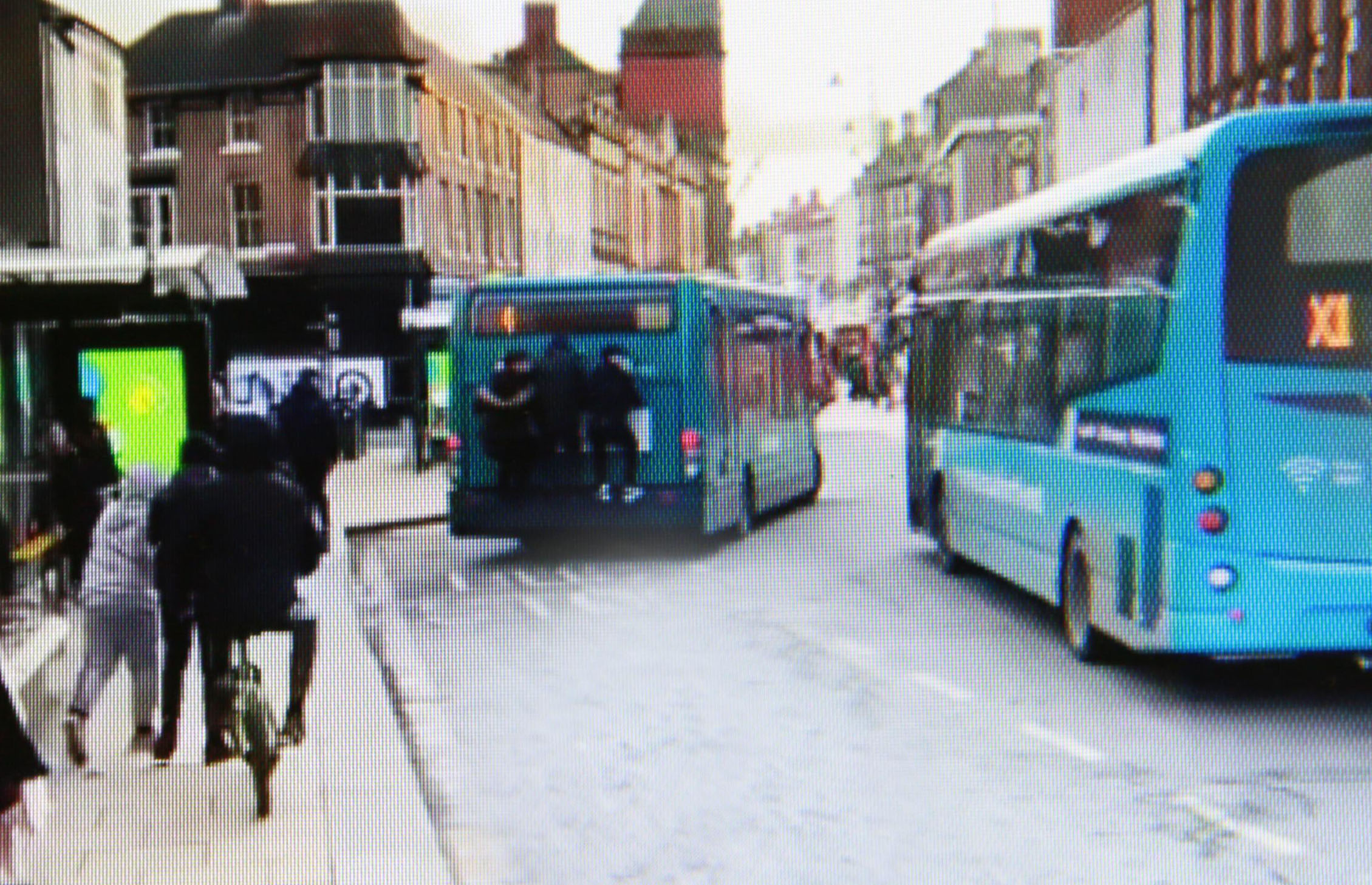 DANGEROUS ACT: Teenagers seen 'clinging' onto bus as it pulls away, an act which shocked John Rutherford, above