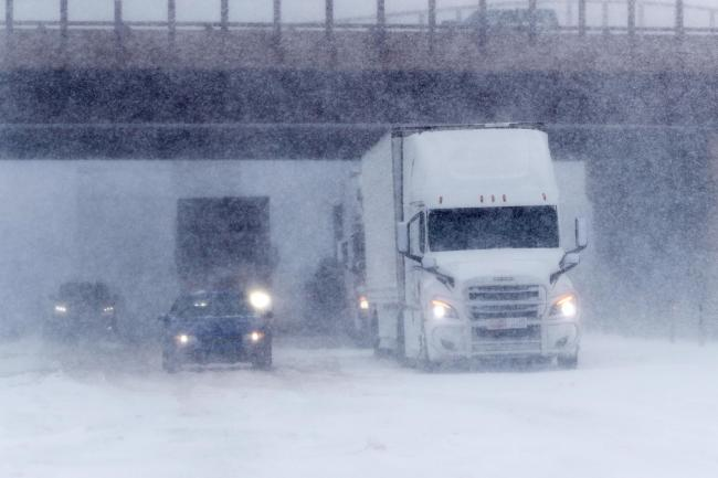 A storm packing hurricane-force winds and snow stopped traffic in Colorado