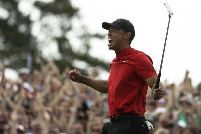 Tiger Woods celebrates winning the Masters